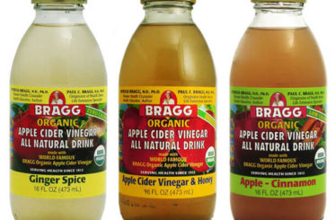 Three jars of different flavors of Bragg Organic Apple Cider Vinegar