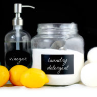 homemade laundry detergent on a table with dryer balls and lemons