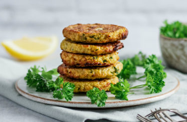 plate with parsley and cauliflower fritters