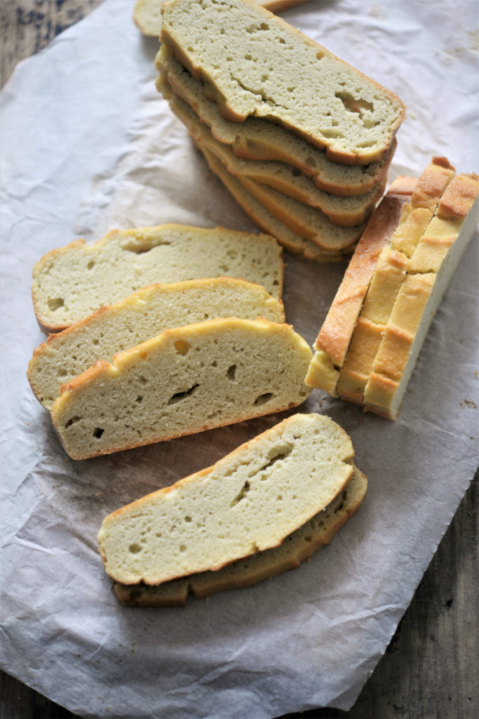 white tea towel with coconut flour bread