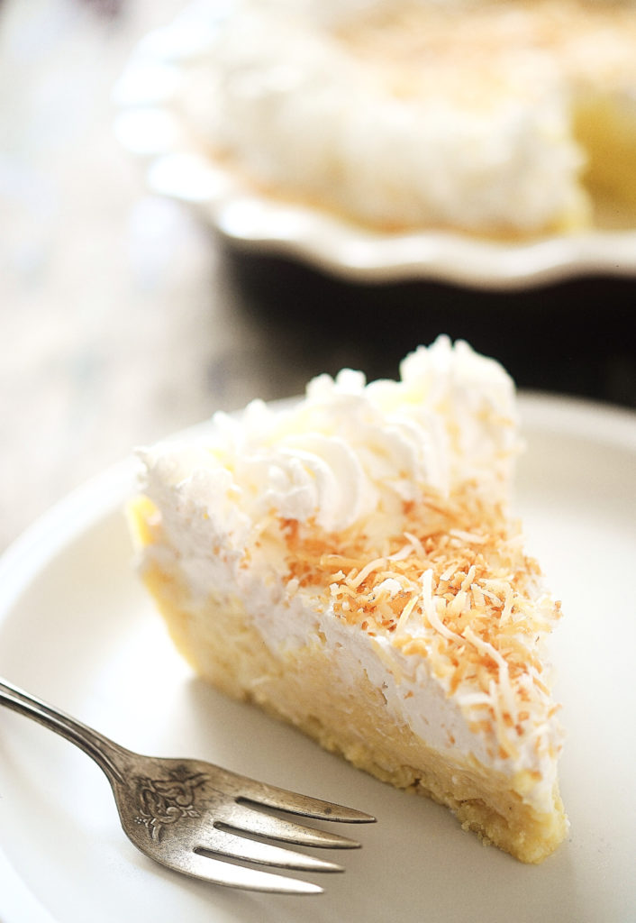 keto coconut cream pie on plate with fork