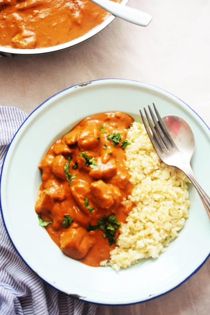 white bowl of keto butter chicken and cauliflower rice