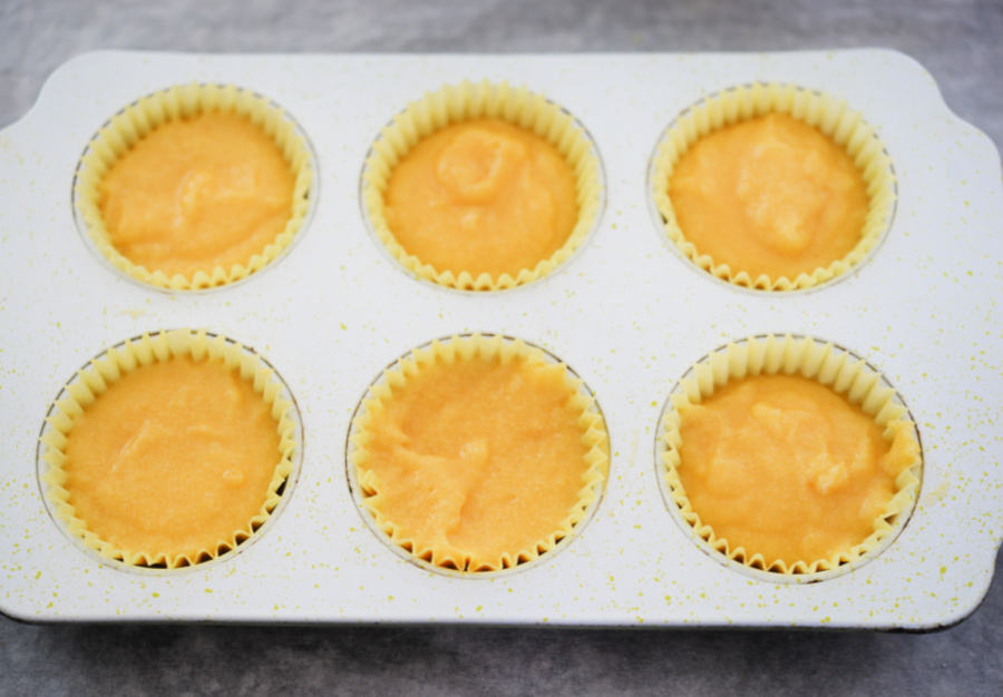 muffin tins filled with batter