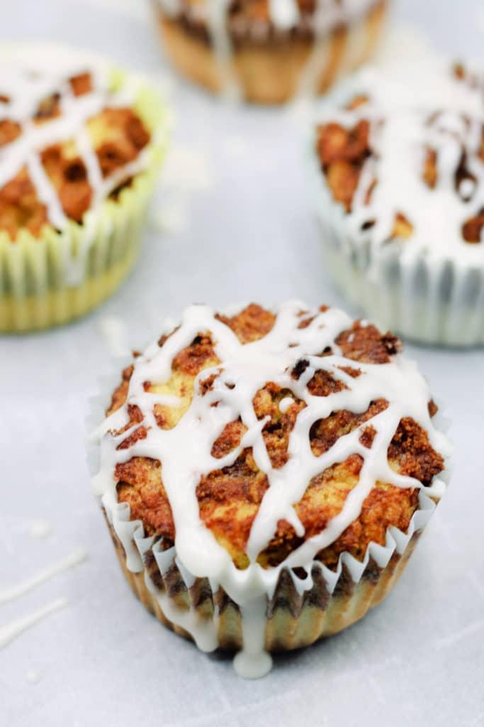 Cinnabon muffins on white parchment paper