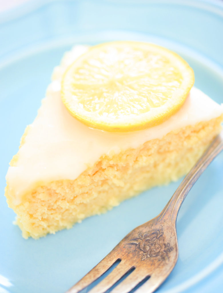 lemon coconut flour cake on a blue plate