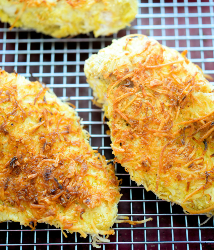 crispy coconut chicken on oven rack