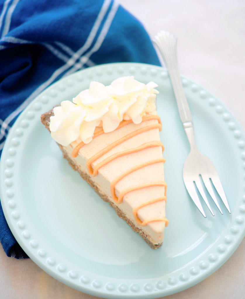 keto peanut butter pie on a light blue plate with a fork