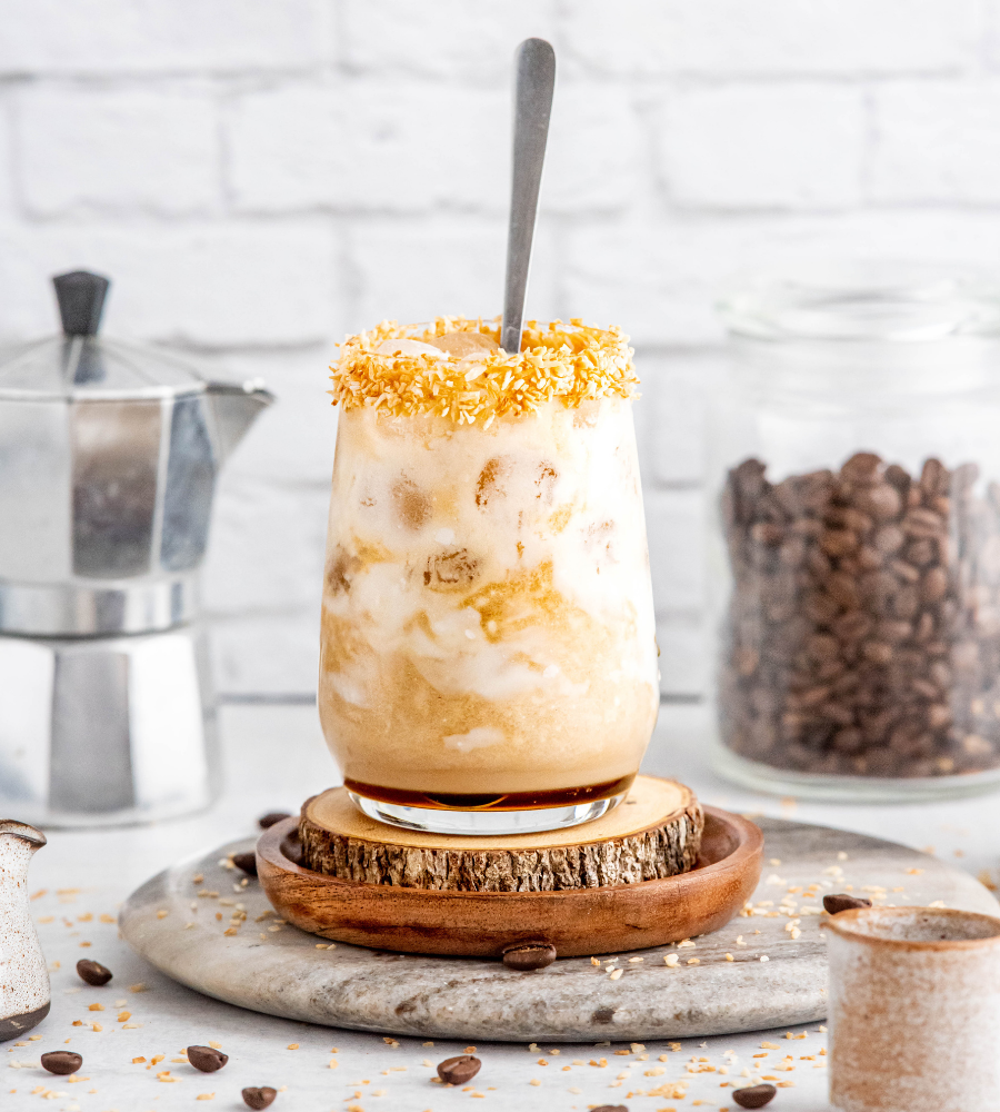 iced coconut milk latte in a glass cup