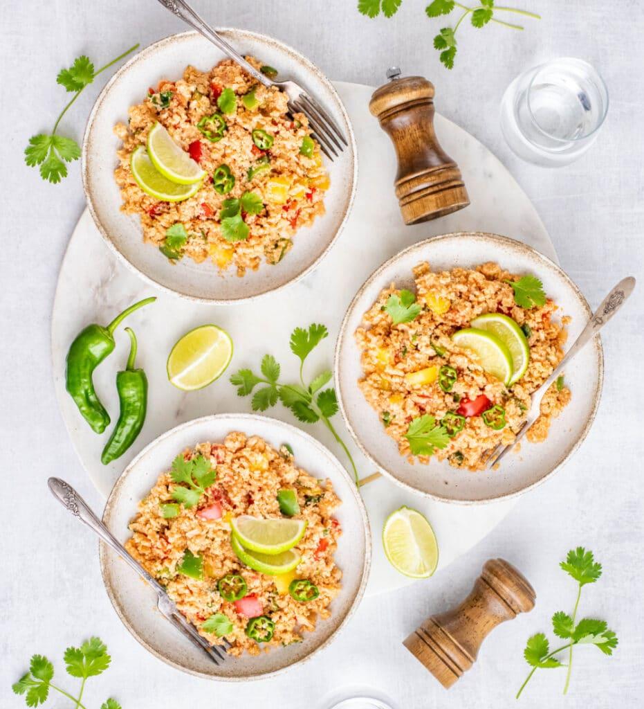 three plates of cauliflower mexican rice